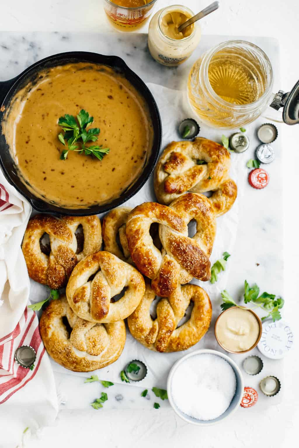 easy homemade soft pretzels with beer cheese dip in cast iron skillet
