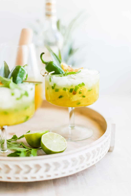 Pineapple jalapeno margaritas in a fancy margarita glass.