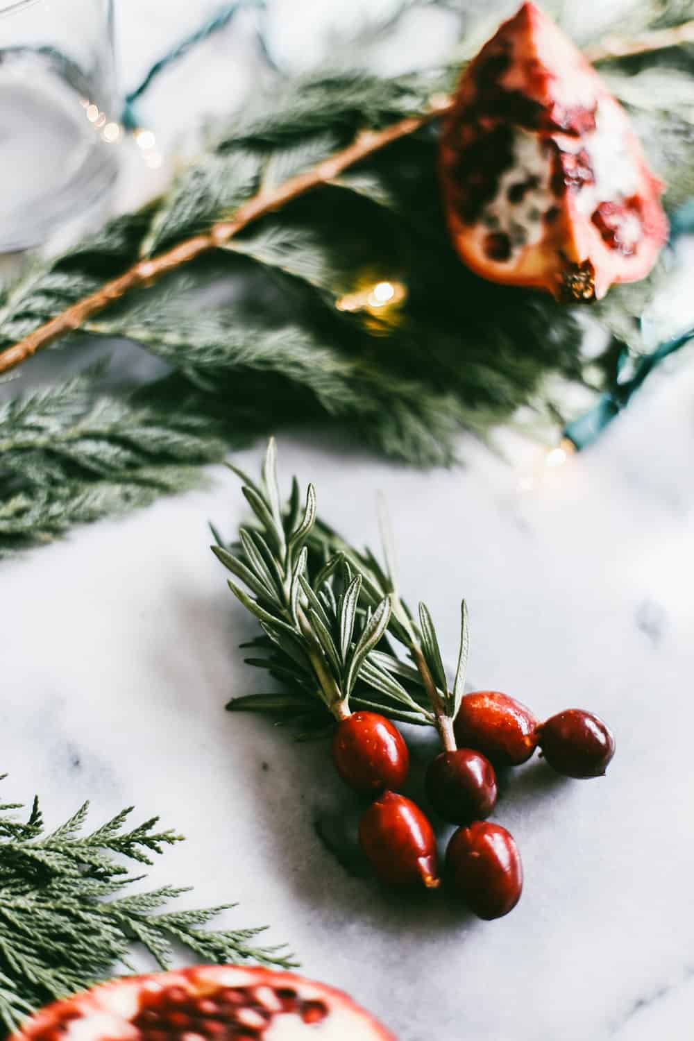 Three rosemary sprigs with cranberries.