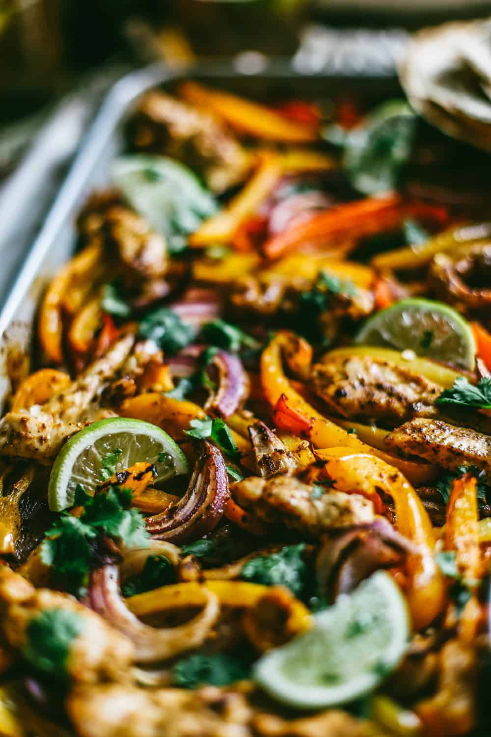 chili lime chicken and vegetables on a sheet pan