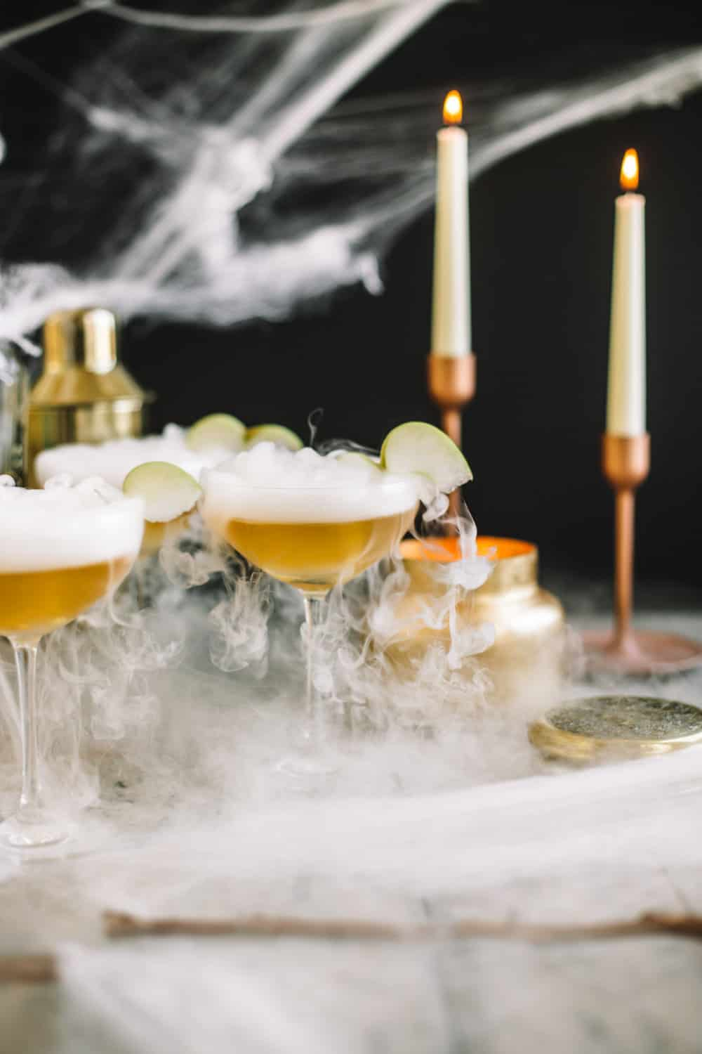Elderflower wand martini with dry ice ,spider webs, and candle sticks.