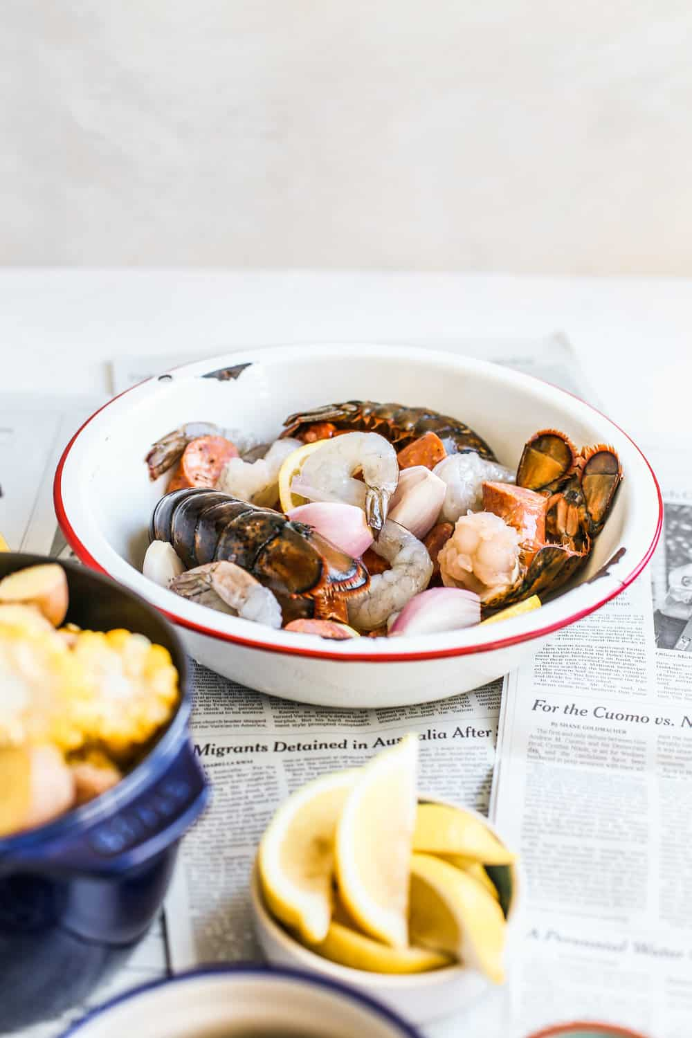 lobster, shrimp, clams in white bowl