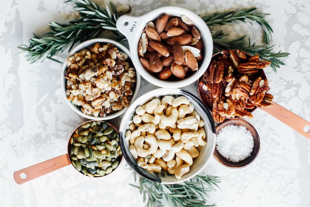 small bowls of different types of nuts.