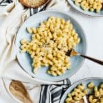stovetop mac and cheese on blue plate with fork