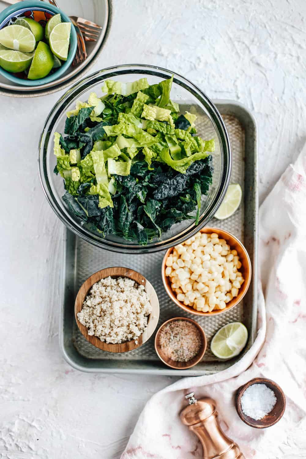 Kale Romaine Golden Corn Quinoa Salt and Lime Salad Ingredients in Mixing Bowls