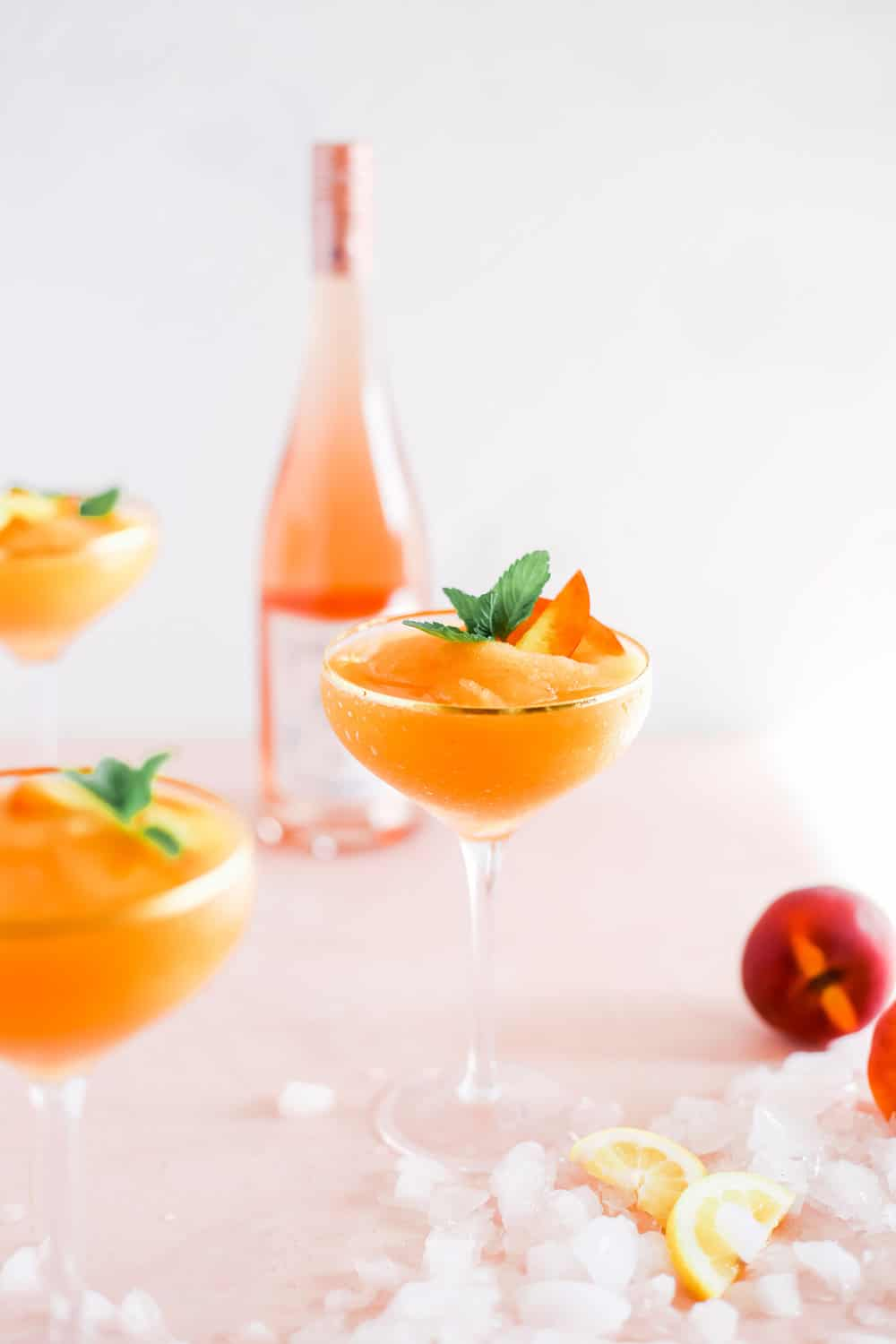 Strawberry Peach Frose in Coupe Glass with Mint