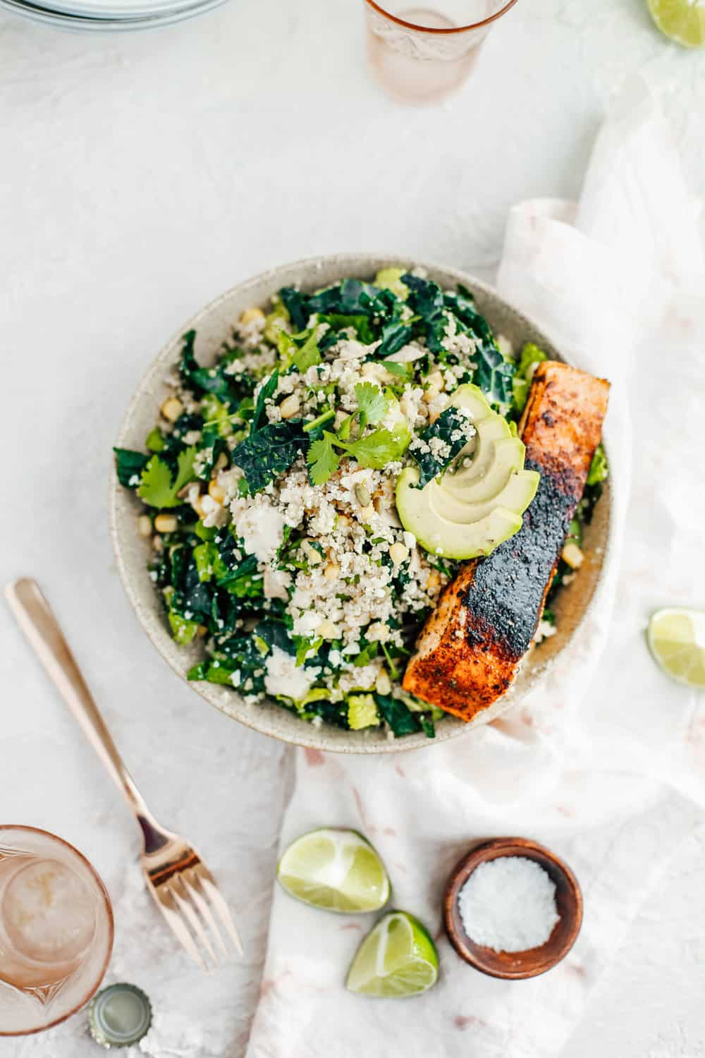 Kale Caesar Salad with Golden Corn Quinoa and Salmon in a Bowl
