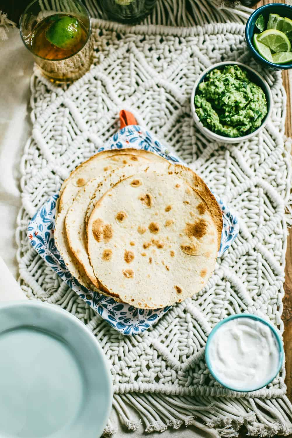flour tortillas with bowl of guacamole on the side