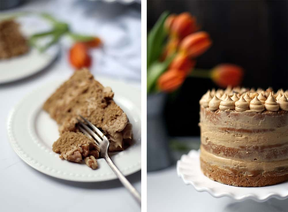 A slice of coffee walnut cake on a white plate with a silver fork.