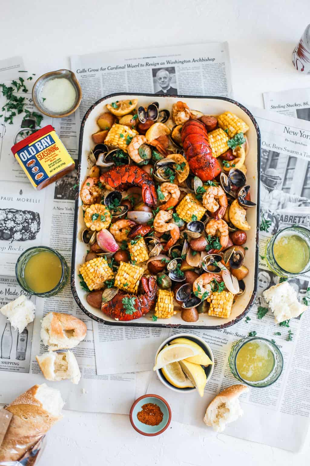 clams, shrimp, lobster, potatoes, corn on sheet pan with old bay and melted butter