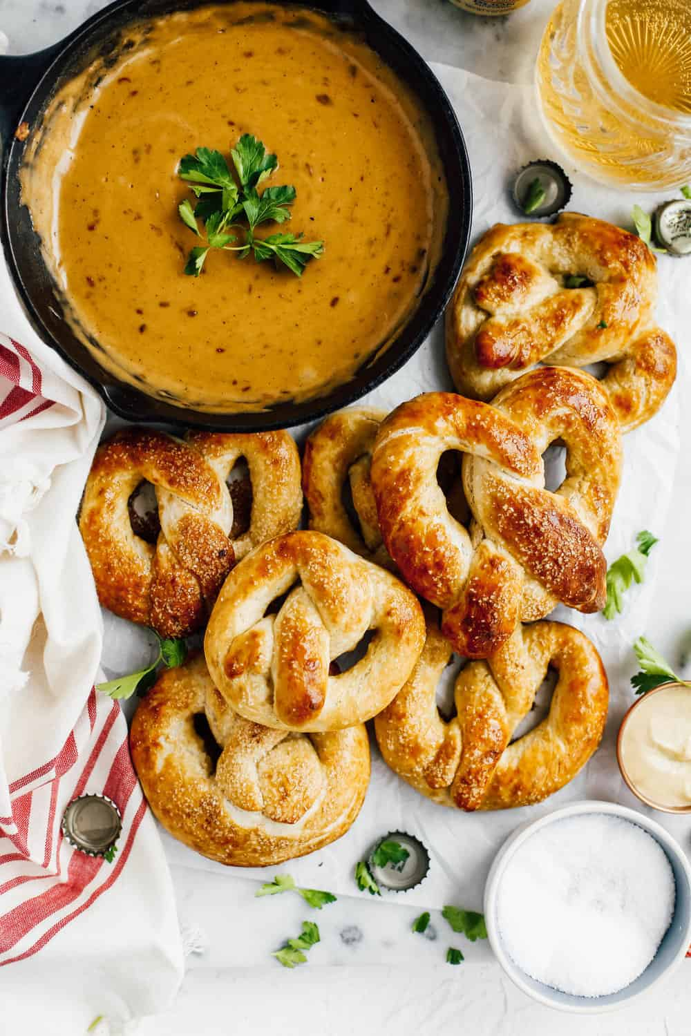 soft homemade pretzels with beer cheese dip in cast iron skillet