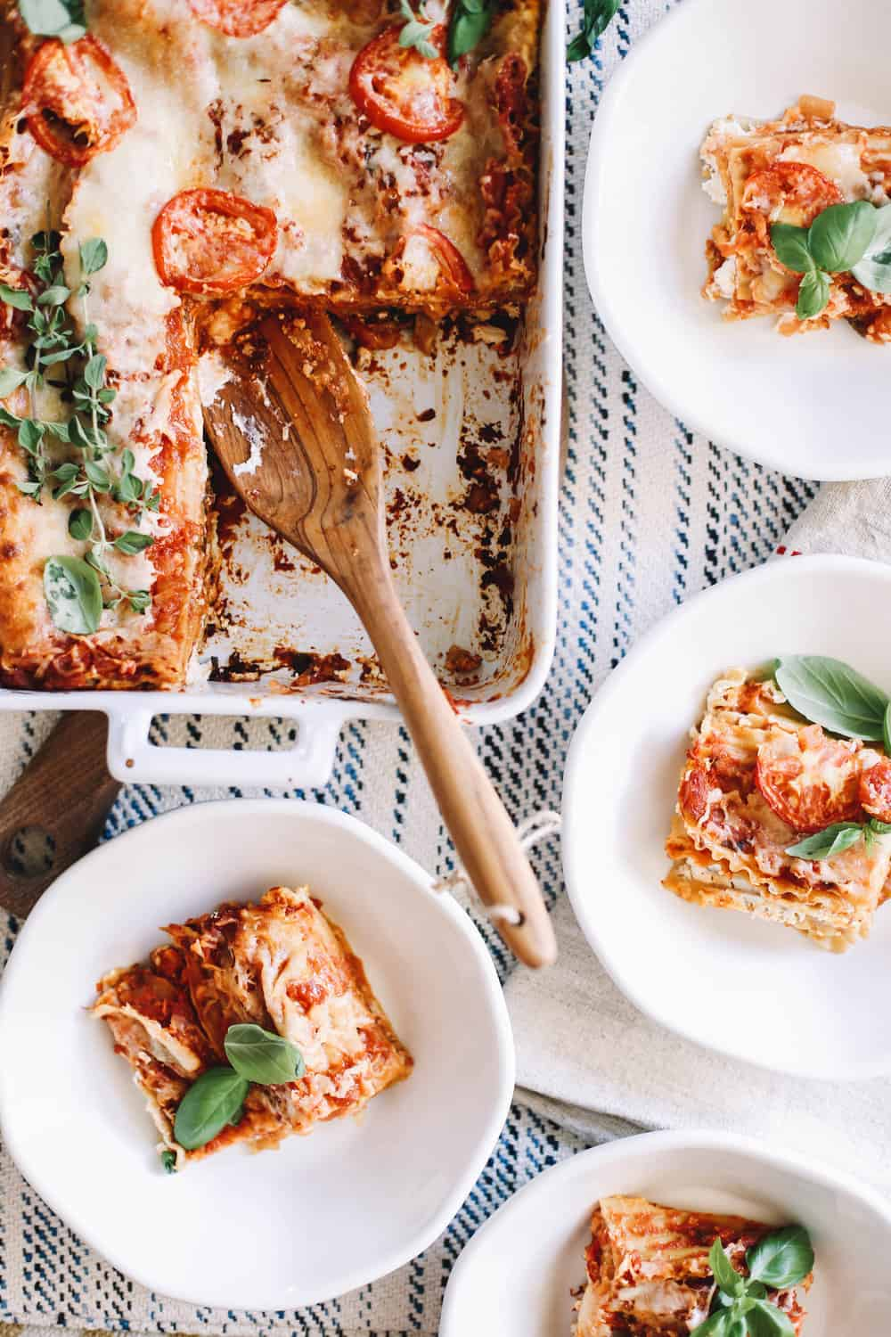 Servings of homemade lasagna in white bowls.