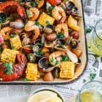 clams, shrimp, lobster, potatoes, corn on sheet pan