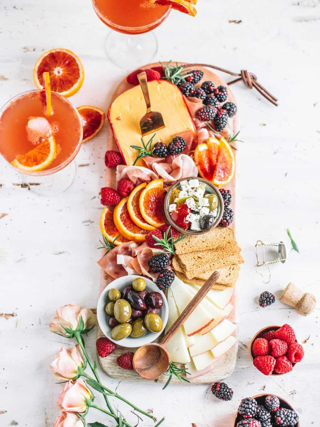 A romantic, date night In, charcuterie board for two. Perfectly curated for Valentines date night or any romantic holiday at home.