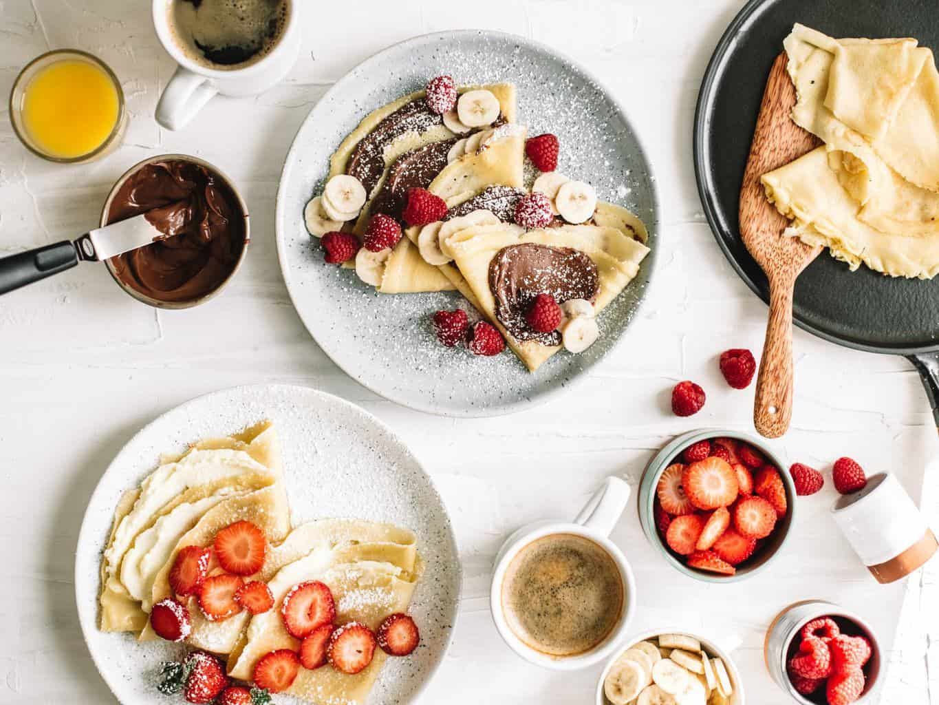 Plates of crepes with toppings.