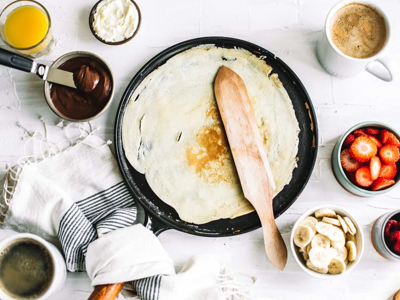 Flipped crepe on a skillet.