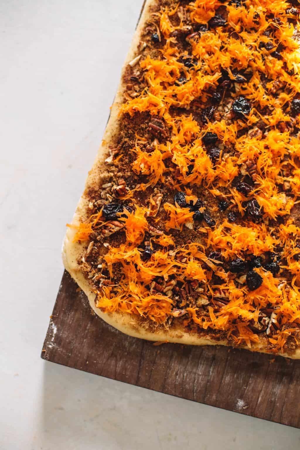 shredded carrot filling over dough