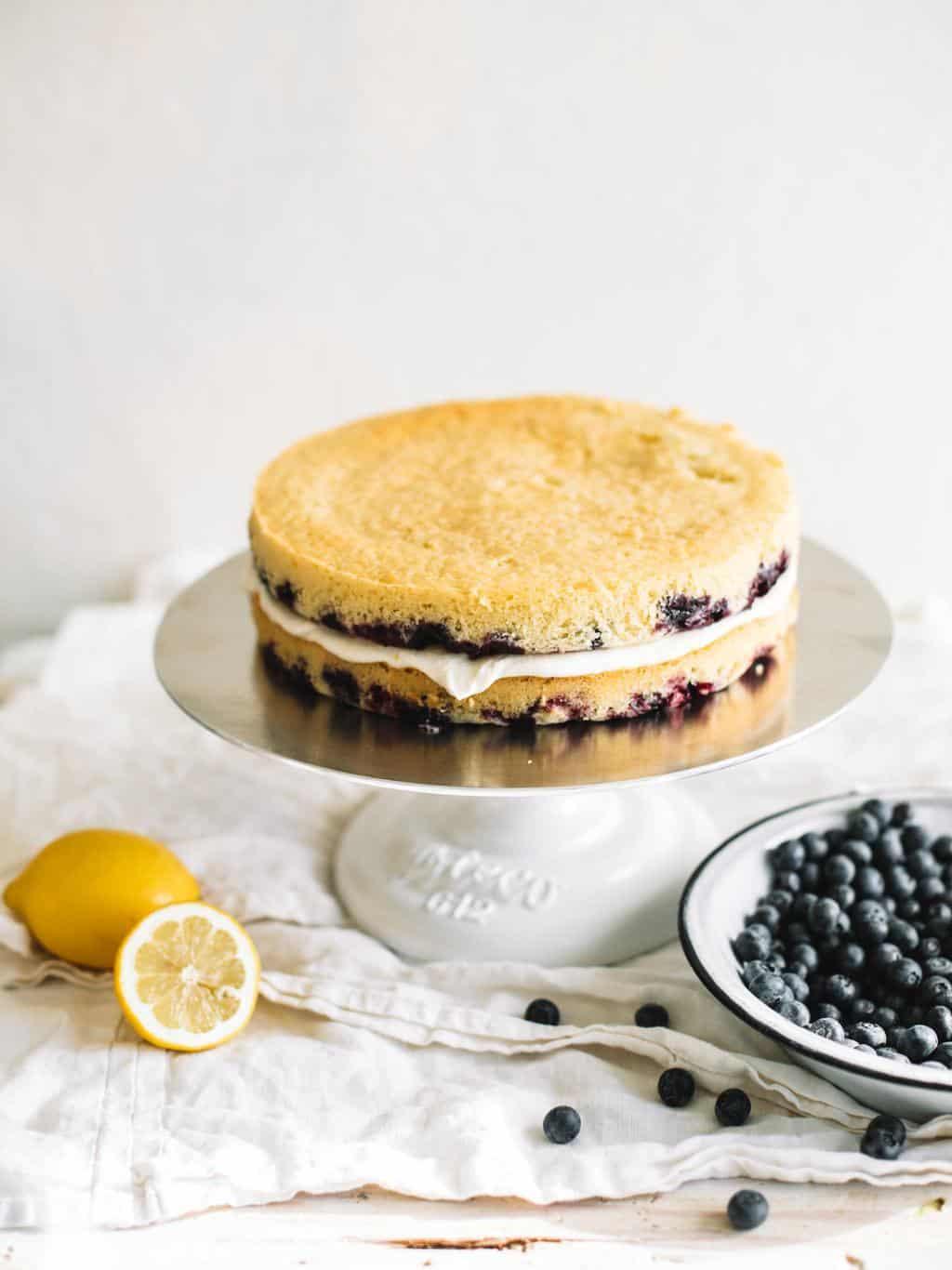 naked spring lemon cake on cake stand