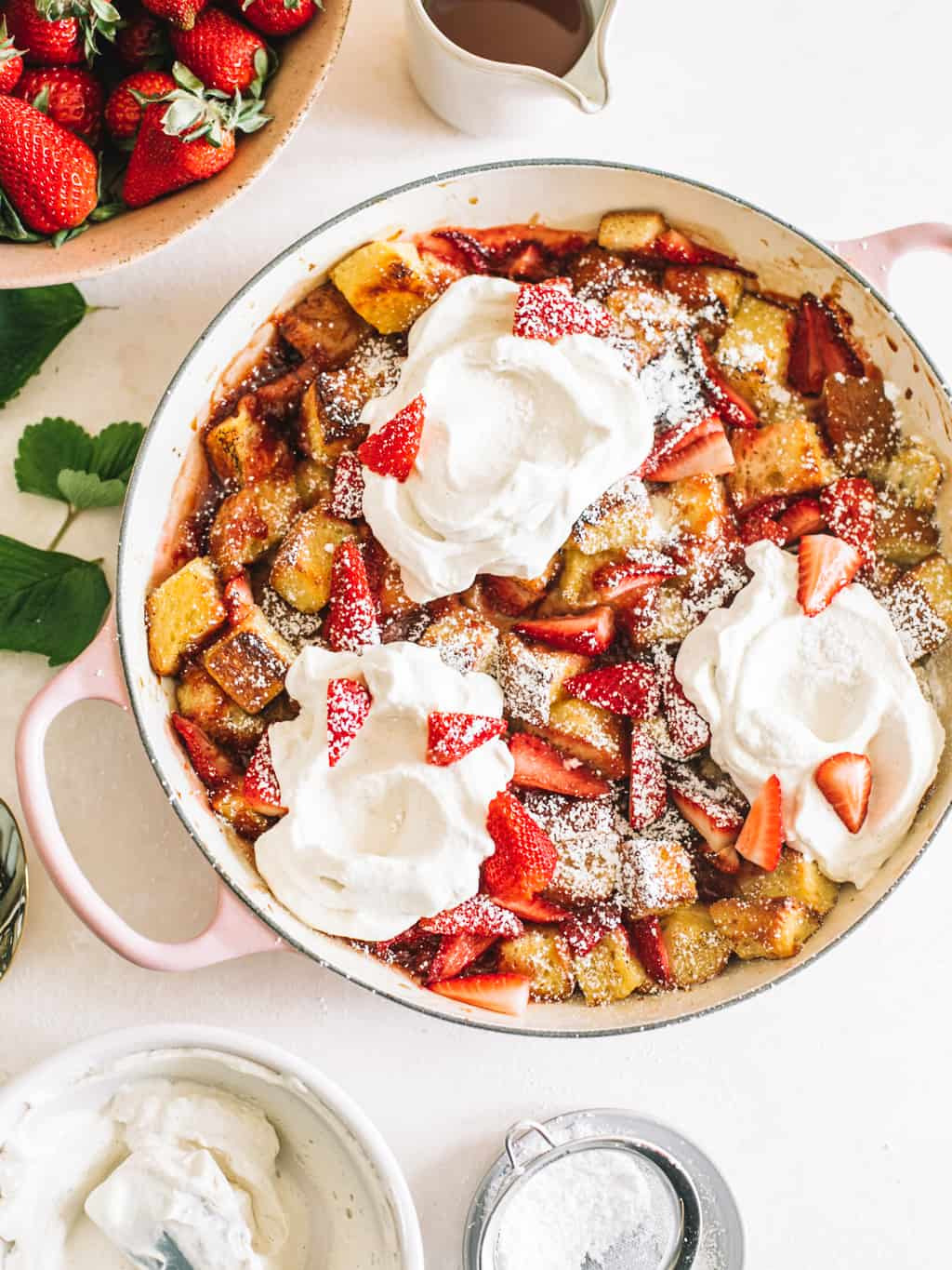 Strawberry and Cream Overnight French Toast in a pink casserole dish