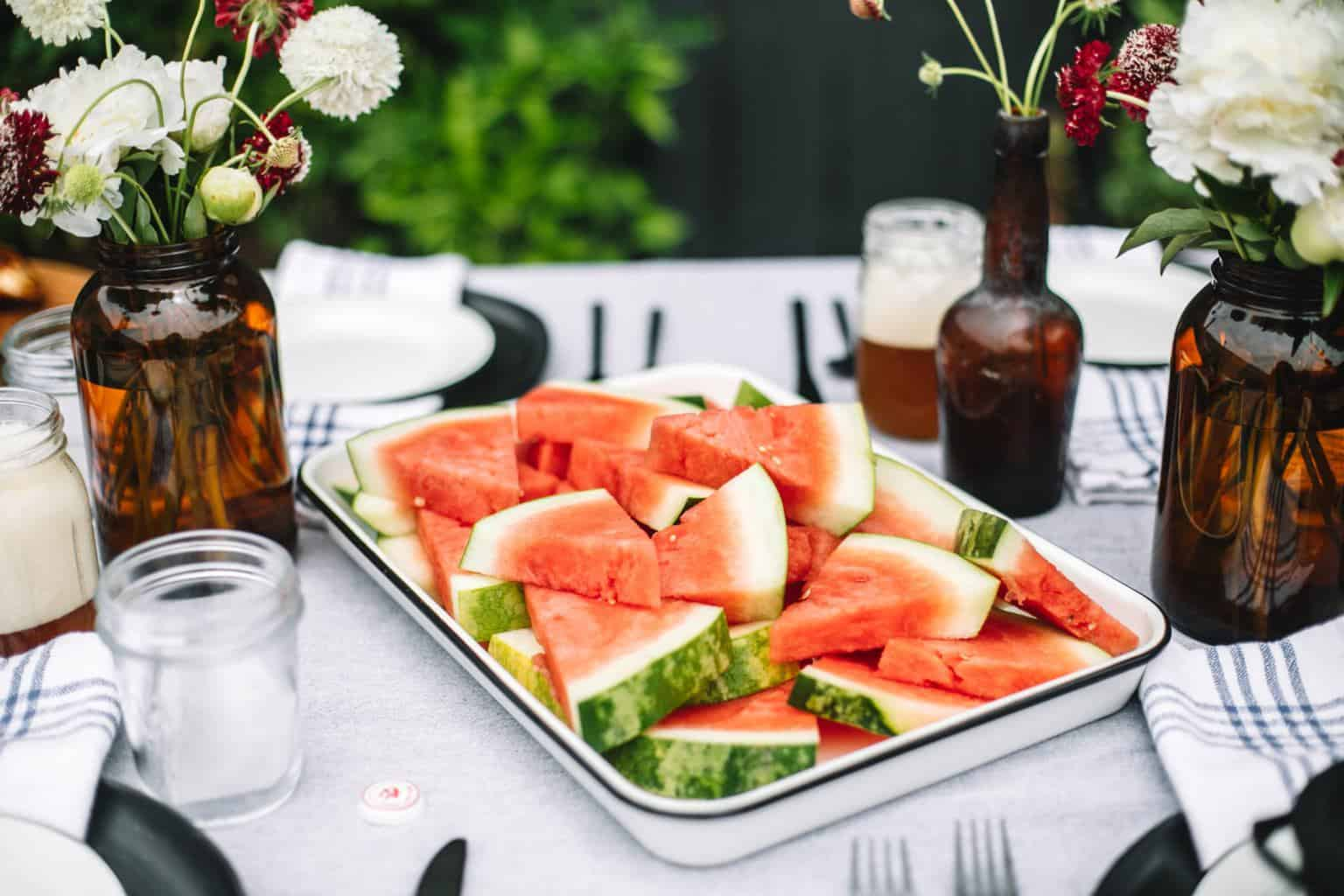 Platter of watermelon on a fathers day bbq table.