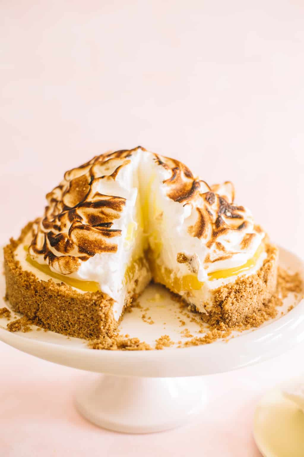 No Bake Lemon Meringue Cheesecake on a white platter