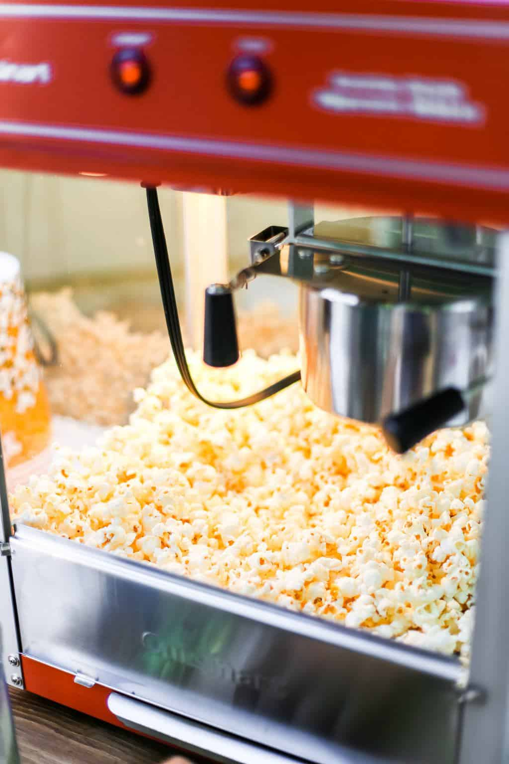 A classic popcorn maker popping popcorn.