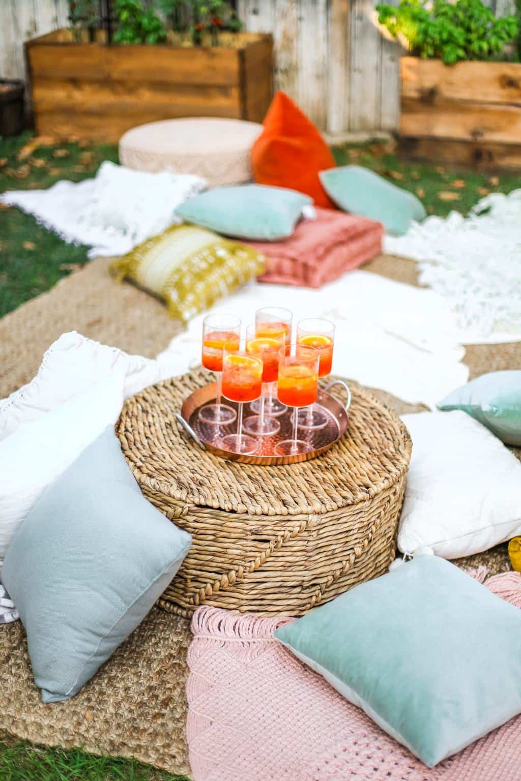 A cozy lounge area with a tray of aperol spritz's for a movie night.