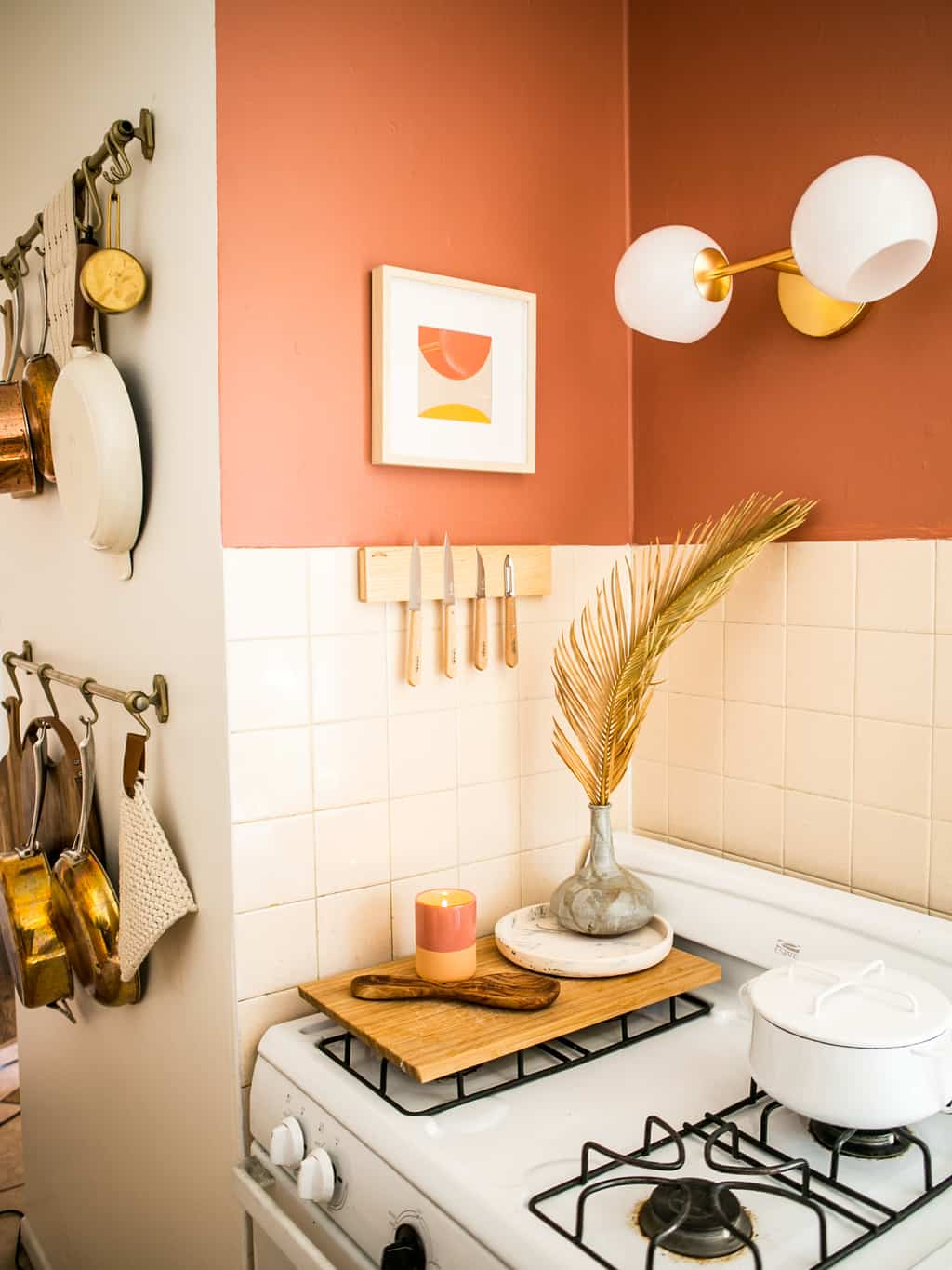 White stove and knife magnet with pan racks.