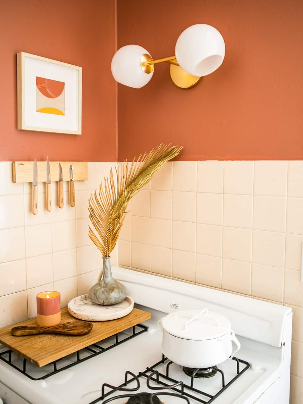 New light fixture with coral walls and a knife magnet.