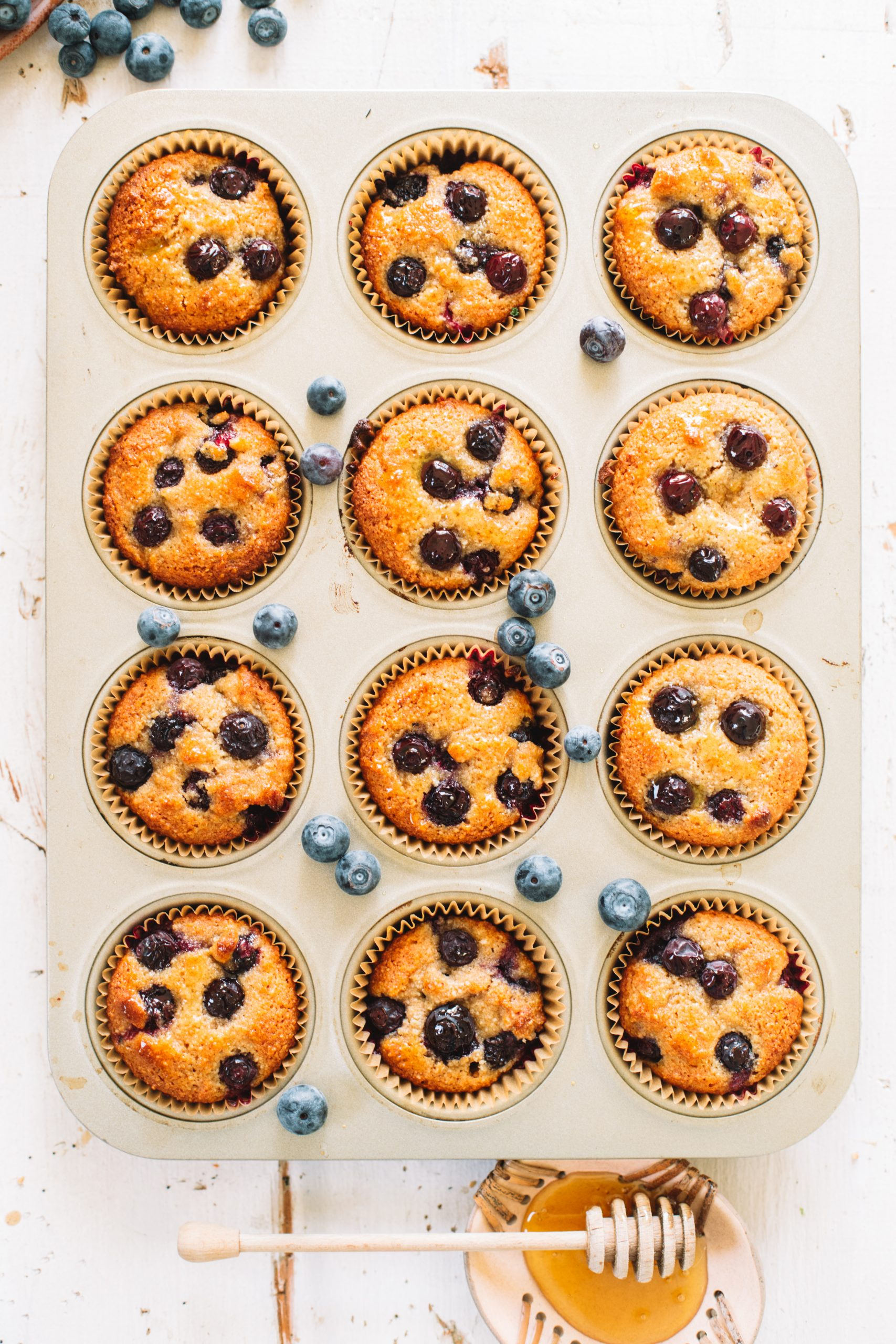 Healthy blueberry muffins baked into a cupcake tin.