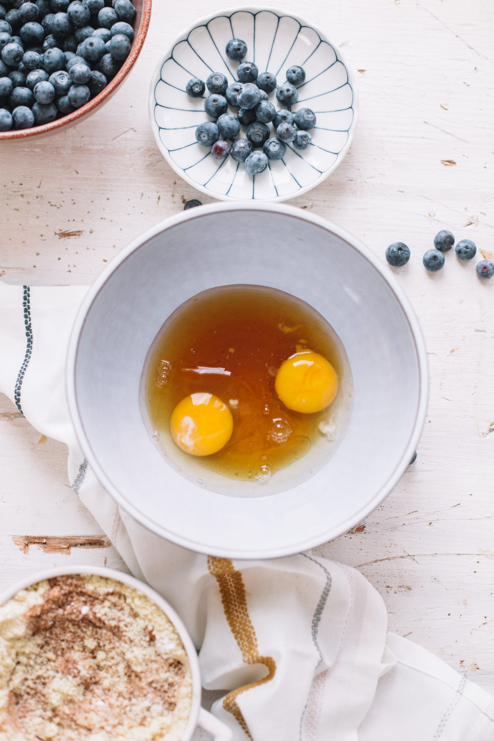 Eggs and honey in a mixing bowl.