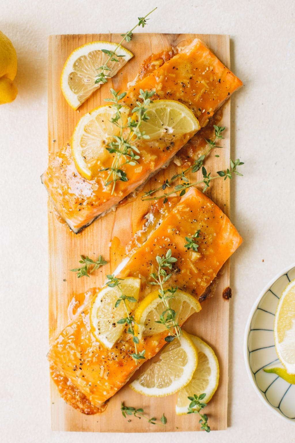 easy cedar planked salmon with lemon slices and fresh thyme