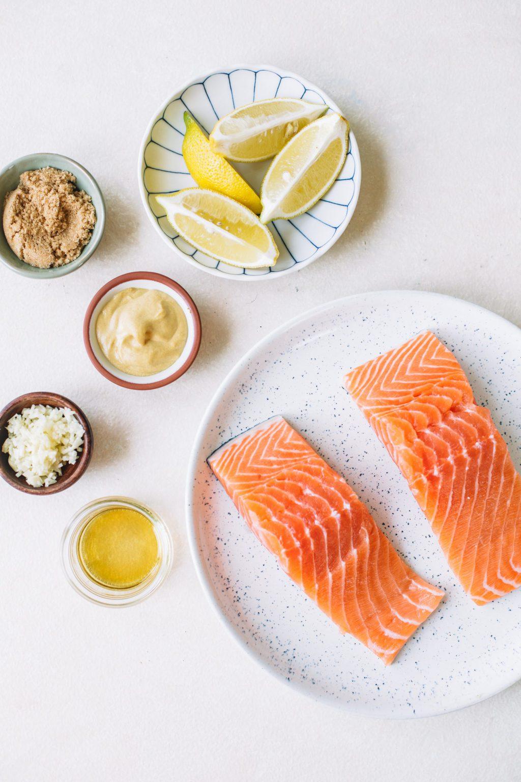 lemon wedges, brown sugar, dijon mustard, garlic, bourbon, salmon fillets