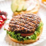 black bean burger patty on bun with lettuce and tomato