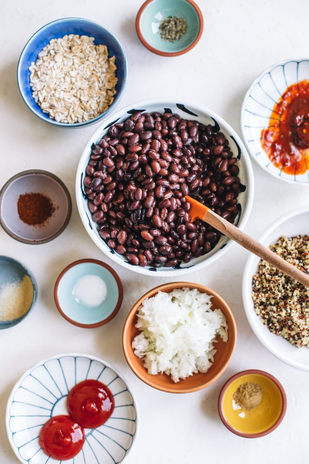 black beans, quinoa, oats, salt, chipotle, spices in bowls