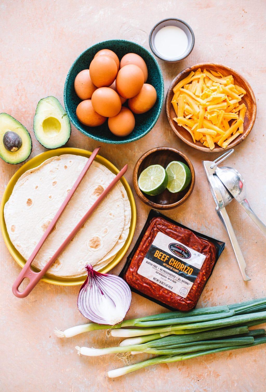 eggs, cheddar cheese, juicer, lime, beef chorizo, flour tortillas, red onion, avocado
