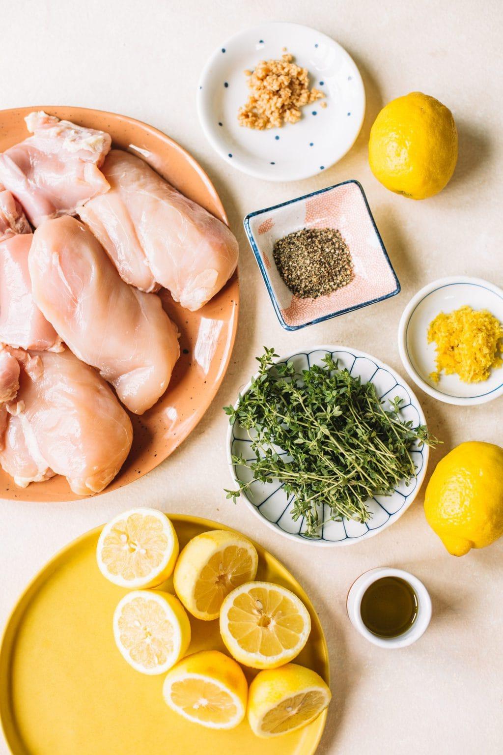 chicken breasts, black pepper, fresh thyme, lemon zest, lemons