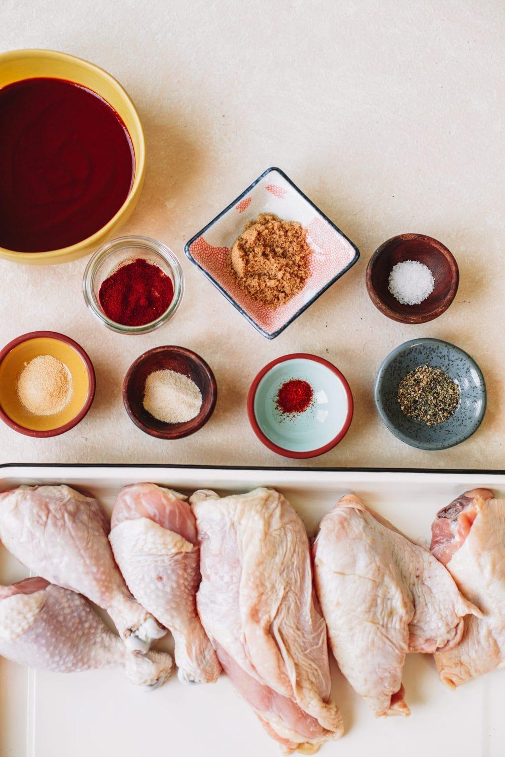 Bbq sauce, garlic powder, smoked paprika, brown sugar, onion powder, cayenne pepper, salt, pepper and bone in chicken.