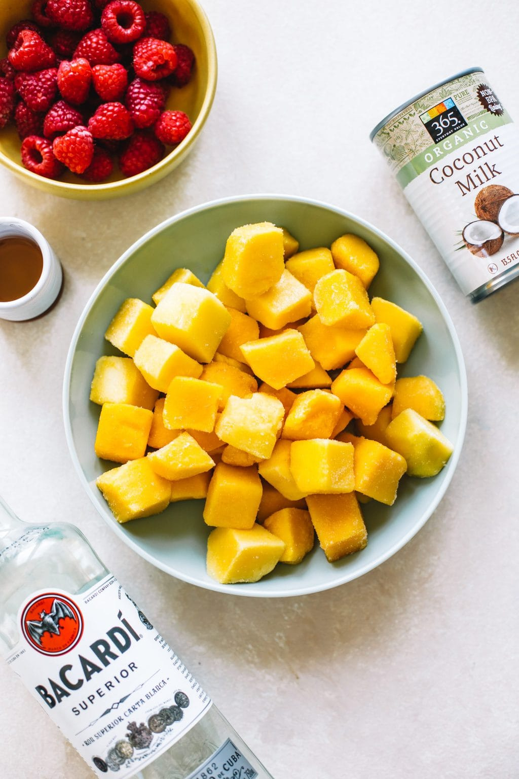 Bowls of ingredients for mango ice cream.
