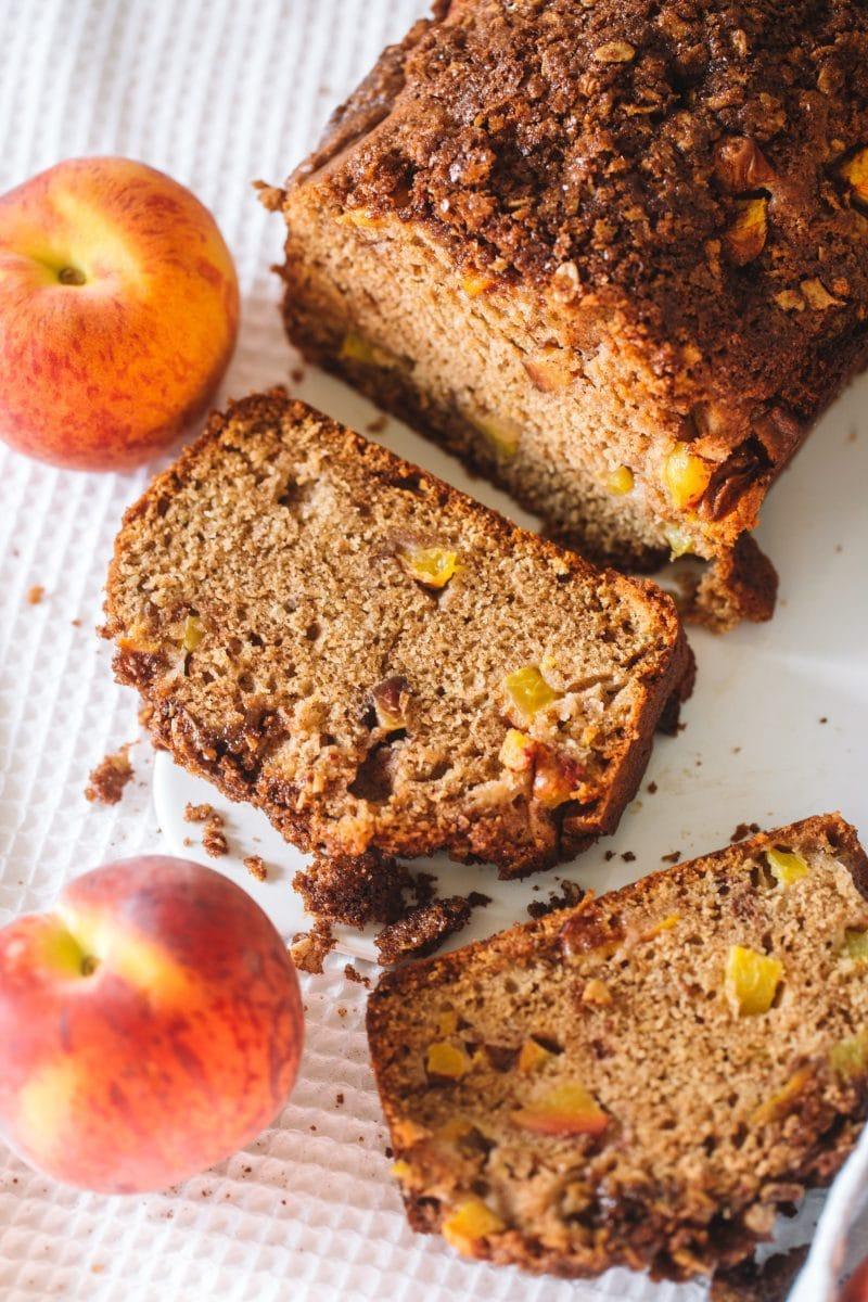 Peach bread with a slice cut off.