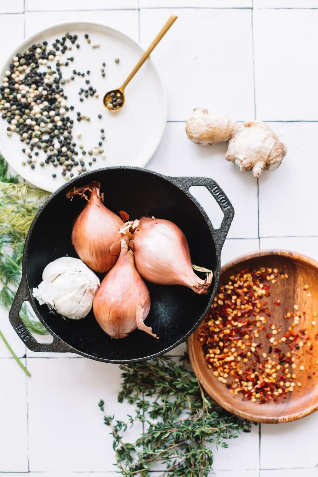 onions, garlic in stockpot with red papper flakes in brown bowl