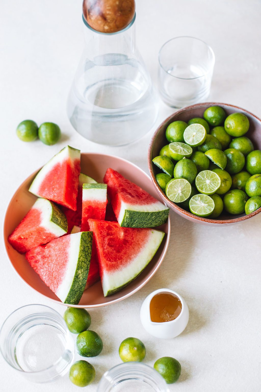 Bowls of watermelon and limes with agave and vodka.