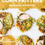 easy zucchini and corn fritters on parchment paper topped with creamy sauce and chives