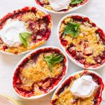 Strawberry dump cakes baked in small white ramekins.