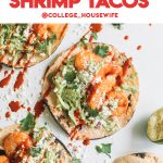 easy chipotle spiced shrimp tacos with slaw and sriracha on white surface