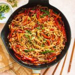 easy chili garlic noodles and sauce with vegetables in cast iron pan