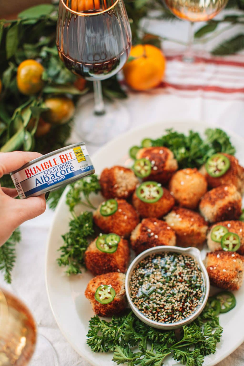 A can of bumble bee tuna with a platter of spicy tuna croquettes.