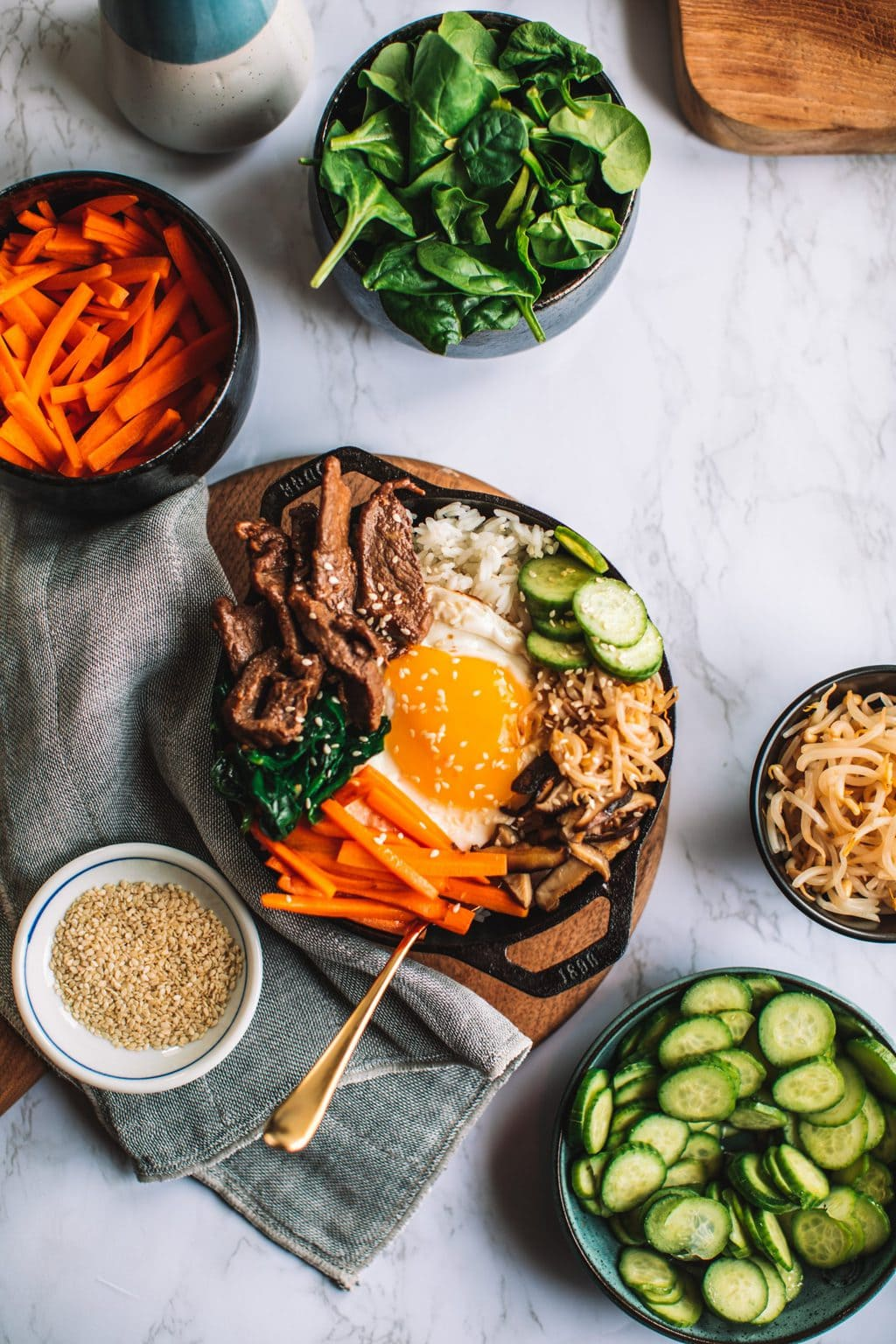 top shot of rice bowl and ingredients in smaller bowls alongside