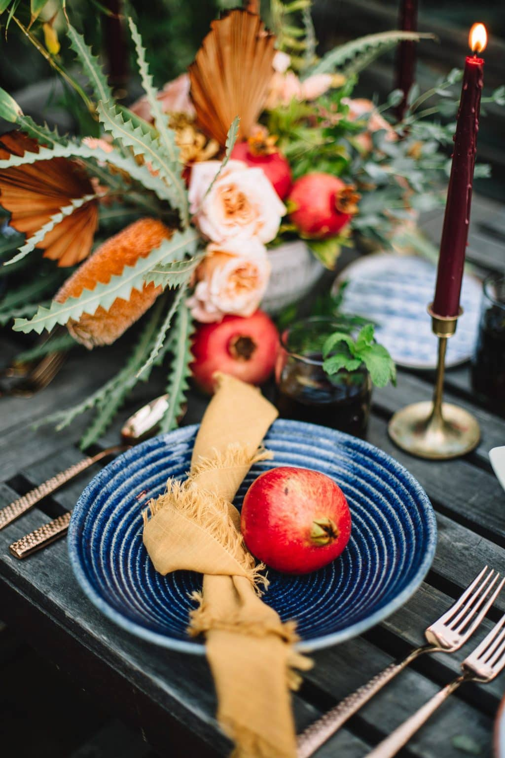 blue plate with yellow napkin on wooden table next to pastel flours