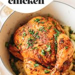 Top shot of whole chicken cooking in large pot on top of vegetables with text overlay.